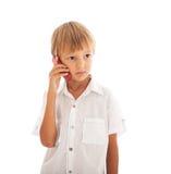 男孩联系在移动电话 库存图片