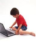 男孩膝上型计算机一点 图库摄影