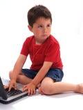 男孩膝上型计算机一点 库存照片