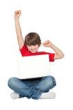 男孩膝上型计算机小坐的赢利地区 图库摄影
