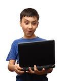 男孩膝上型计算机惊奇 库存照片