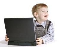 男孩膝上型计算机 免版税库存图片
