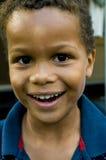男孩色的逗人喜爱微笑 库存图片