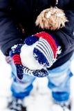 男孩获得乐趣在雪 免版税图库摄影