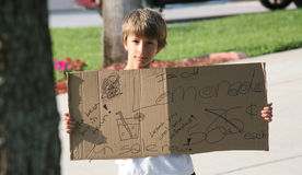 男孩藏品柠檬水销售额符号 库存图片