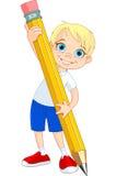 男孩藏品铅笔 免版税图库摄影