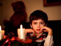 男孩蜡烛圣诞节新年度 免版税库存照片