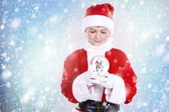 男孩装饰了作为在冬天设置的圣诞老人 免版税库存图片