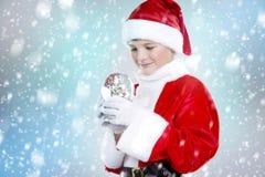 男孩装饰了作为在冬天设置的圣诞老人 免版税库存照片