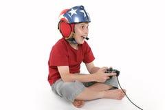 男孩计算机享受比赛使用 图库摄影
