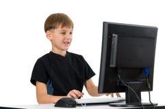 男孩计算机他的 免版税图库摄影