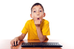 男孩计算机前开会 库存图片