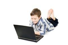 男孩计算机年轻人 免版税库存照片