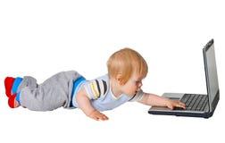 男孩计算机运行 免版税库存图片
