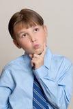 男孩认为 免版税库存图片