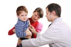男孩诊断医生一点 免版税库存照片