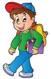 男孩走的动画片学校 免版税库存图片
