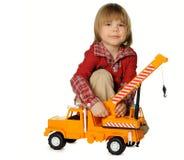 男孩起重机少许玩具卡车 免版税库存图片