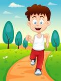 男孩跑步 免版税库存照片