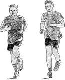 男孩跑步 免版税图库摄影