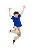 男孩跳的年轻人 免版税库存图片