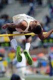男孩跳高运动员学校 免版税库存照片