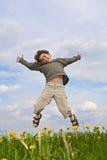 男孩跳 免版税图库摄影
