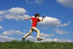 男孩运行中 免版税图库摄影