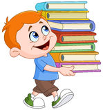 男孩运载的书 免版税库存图片