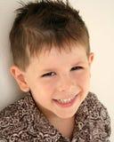 男孩逗人喜爱微笑 免版税库存照片