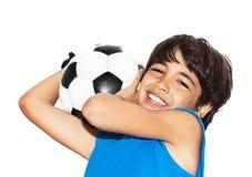 男孩逗人喜爱橄榄球使用 库存照片
