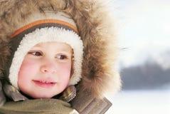 男孩逗人喜爱的孩童用防雪装 库存图片