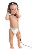 男孩逗人喜爱的耳机老一佩带的年 免版税库存照片