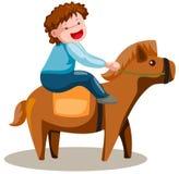男孩逗人喜爱的马骑术 免版税库存照片