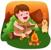 男孩野营的吉他使用 免版税库存照片