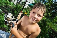男孩钓鱼竿 免版税库存照片
