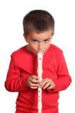 男孩长笛使用的一点 免版税库存照片