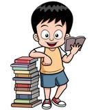 男孩阅读书 免版税库存照片