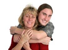 男孩青少年他的妈妈 免版税图库摄影