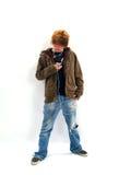 男孩青少年的MP3播放器 免版税库存图片