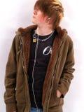 男孩青少年的MP3播放器 免版税图库摄影