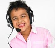 男孩顶头电话佩带 免版税图库摄影