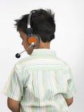 男孩顶头电话 免版税库存图片
