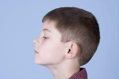 男孩顶头配置文件射击端年轻人 免版税库存图片