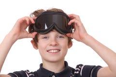 男孩风镜滑雪 库存照片