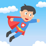 男孩飞行天空超级英雄 免版税库存照片