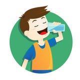 男孩饮用水 库存照片