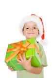 男孩骄傲的圣诞节礼物 库存照片