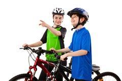 男孩骑自行车者女孩查出的白色 库存图片