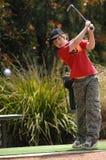 男孩高尔夫球运动员 免版税库存照片